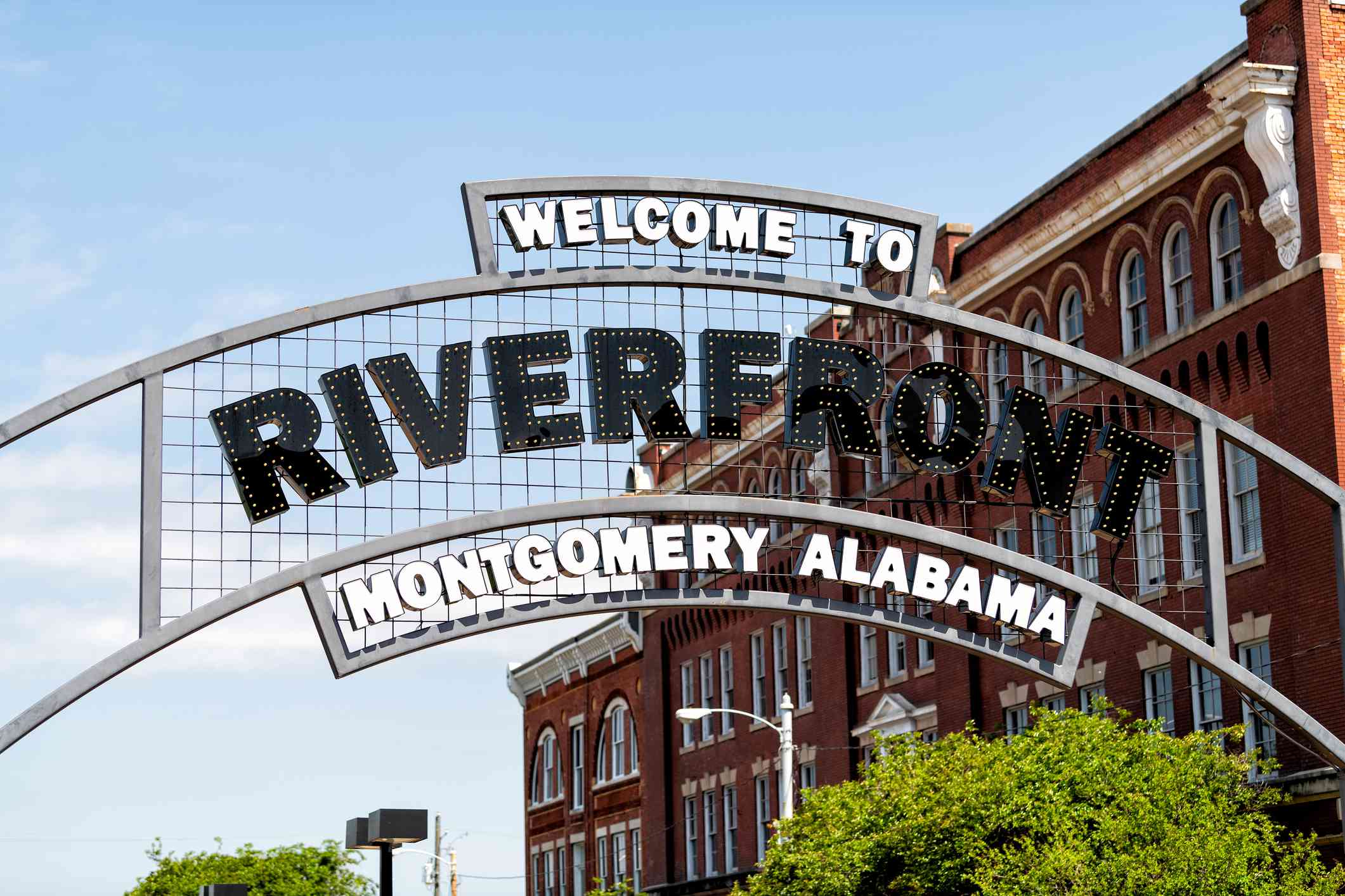 Welcome to Riverfront park illuminated sign with buildings in background in capital Alabama city of Montgomery in old town