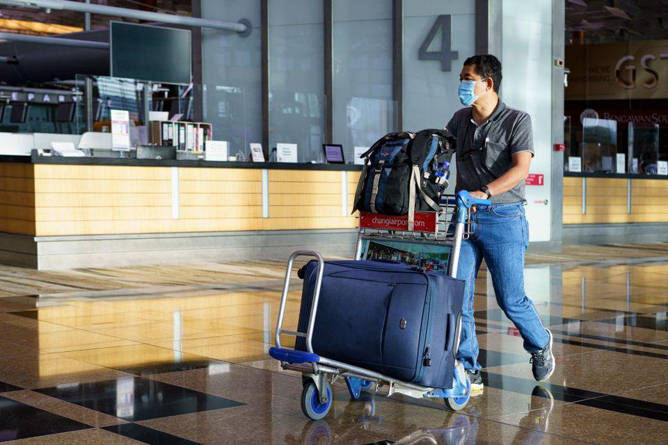 Masked traveler in Singapore Changi Airport