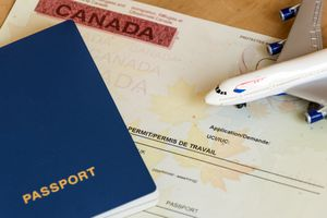 Canadian work permit paper document and passport top view.
