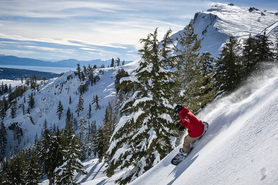 A snowboarder at rides down a mountain at Squaw Valley in Lake Tahoe