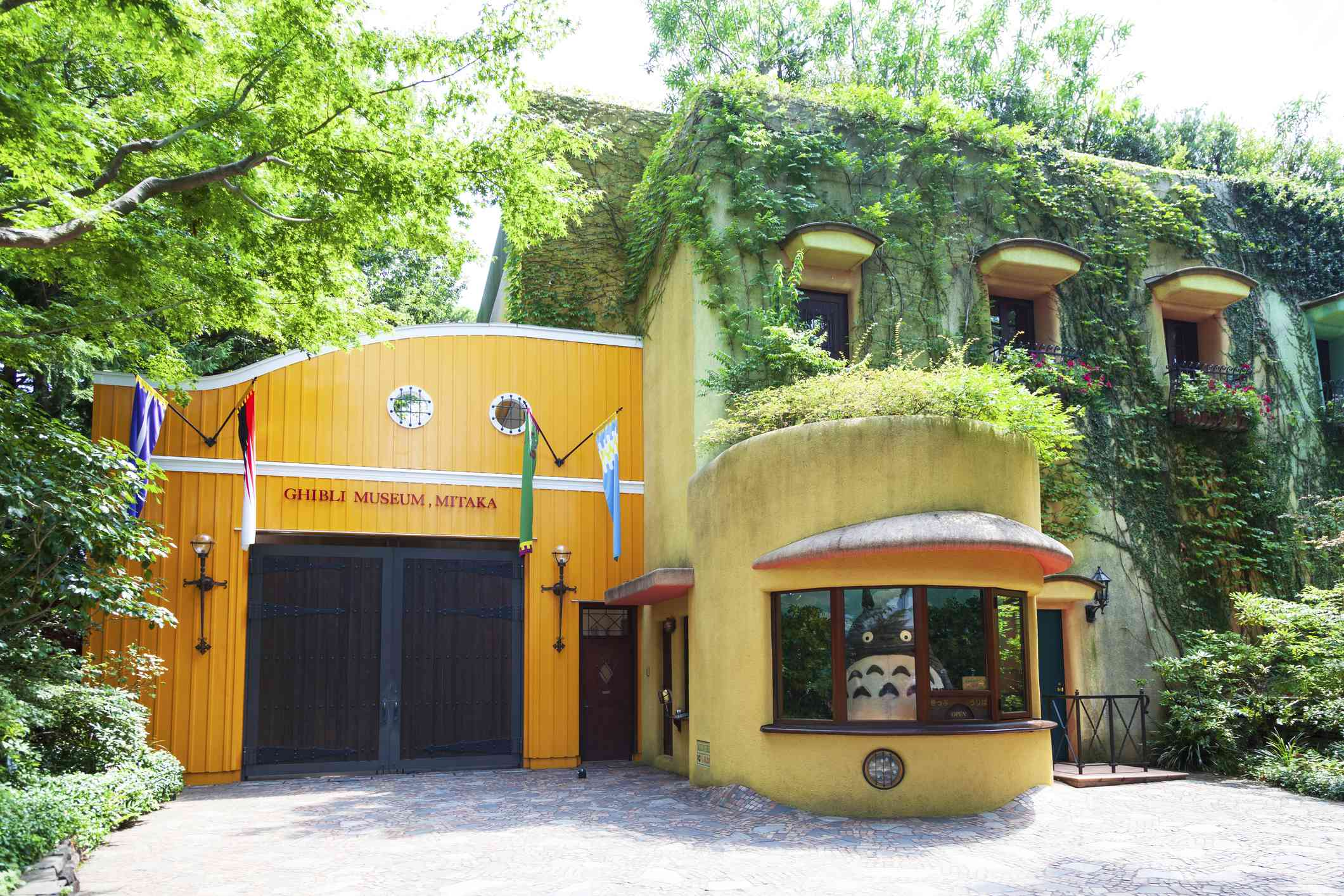 entrance to the Ghibli museum with a statue of Totoro peering out a window