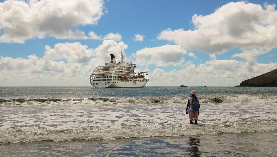 Woman looking at Aranui 5 ship