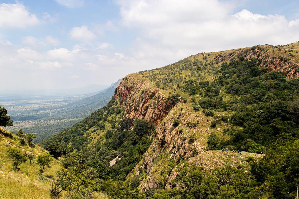 Hikers standing on a ridge in the Magaliesberg Mountains, Gauteng