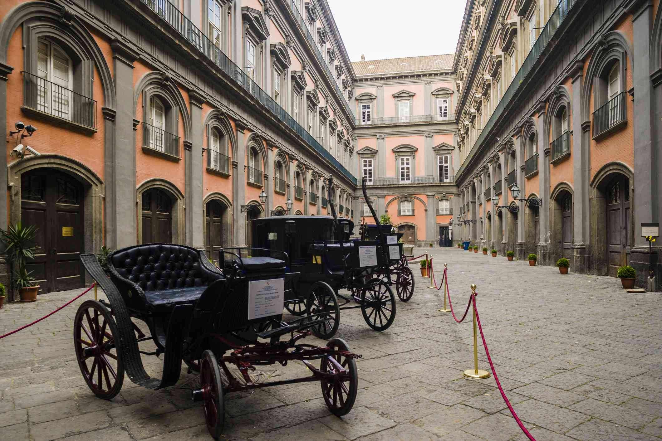Antique coaches in a courtyard of the Palazzo Reale