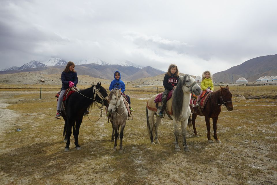 Horseback riding on Karakul Lake
