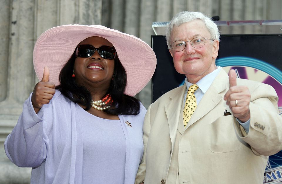 Movie Critic Roger Ebert and his wife, Chaz Ebert, gesture as he receives the 2,288th Star on the Hollywood Walk of Fame.