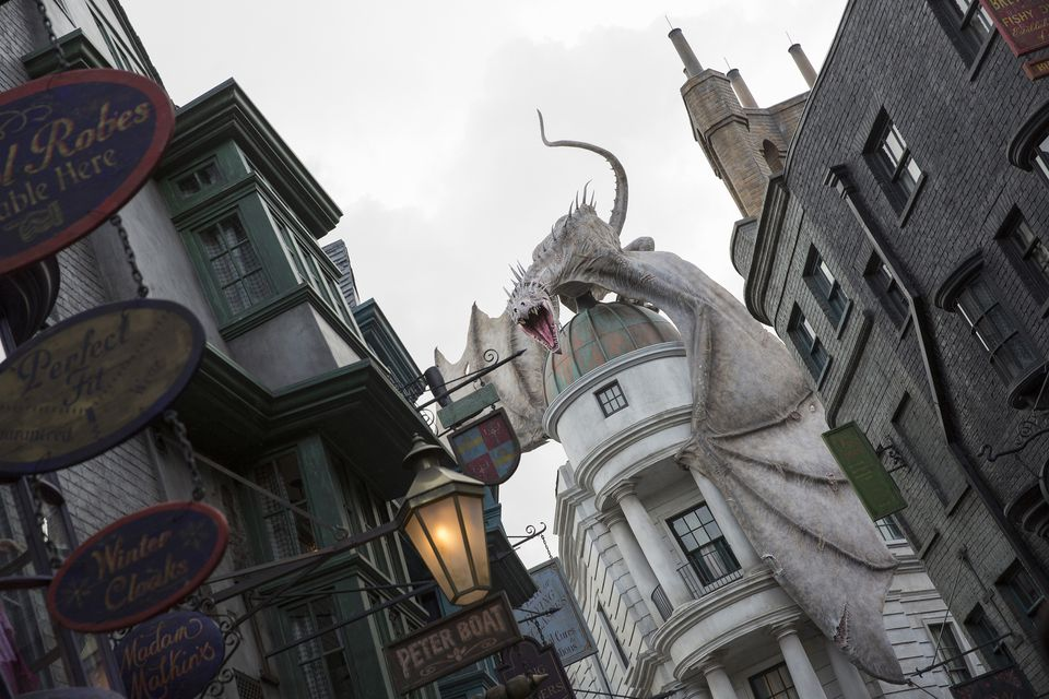 The fire-breathing dragon that looms over the entrance to the Escape From Gringotts ride