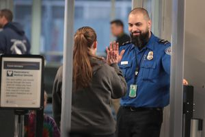 TSA Agents Work At Airport Security