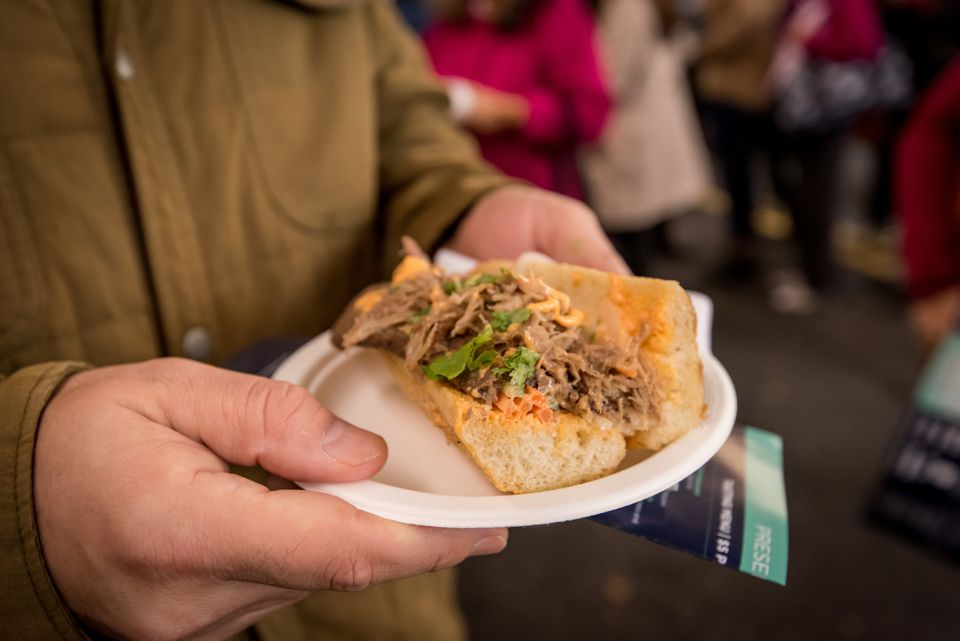 A man holds a sandwich at the Taste of Georgetown festival
