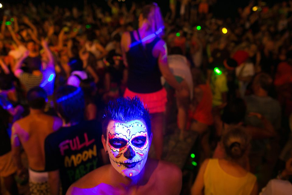 Man with painted face at Thailand's Full Moon Party