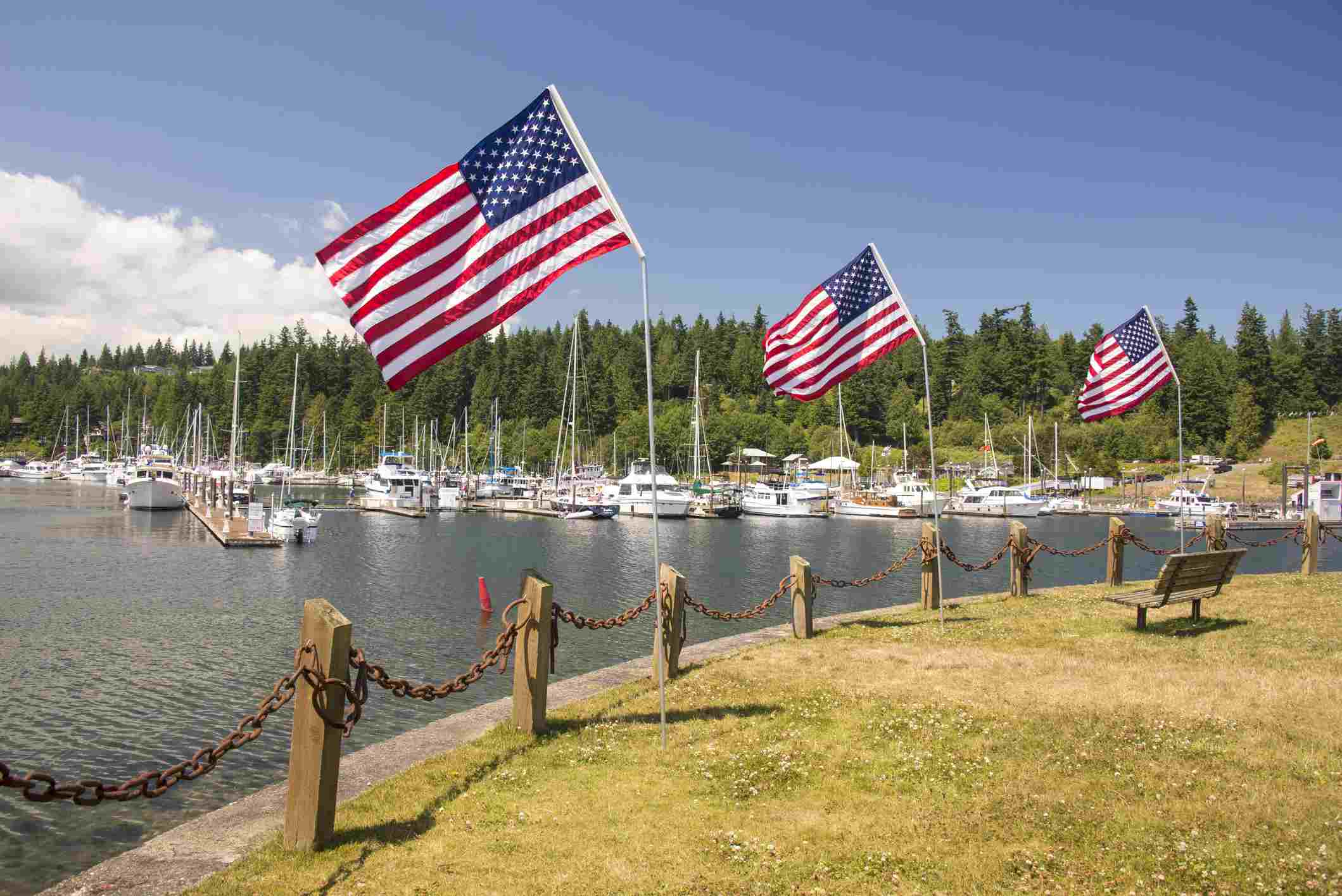 Waterfront Resort and marina at entrance to Hood Canal, 4th of July flag display, Port Ludlow, Washington State, USA