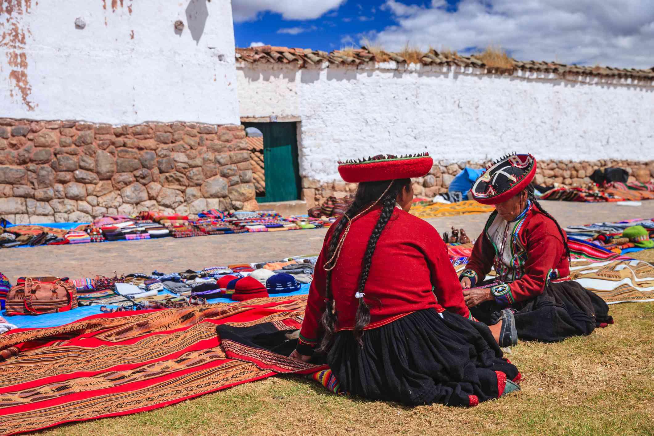 Peruvian women selling souvenirs at Inca ruins, Sacred Valley, Peru