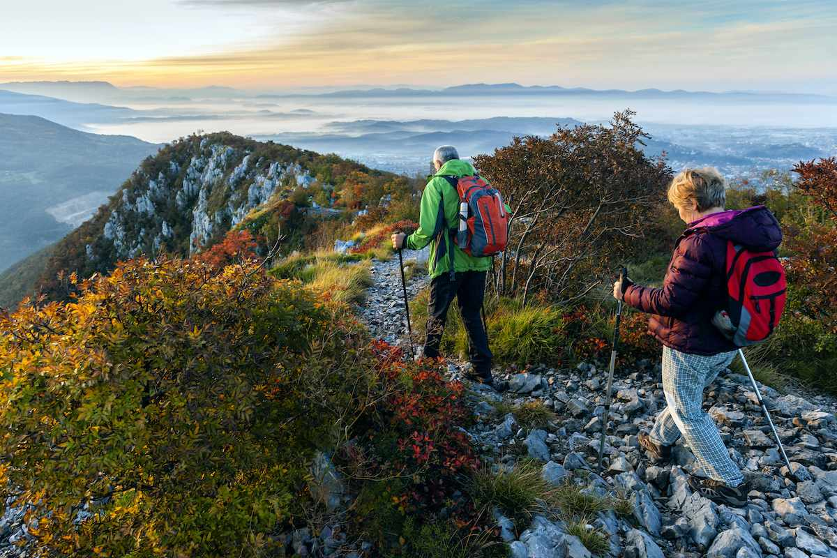A couple hikes along a trail in the Juliana Alps of Slovenia