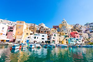 Colorful houses and boats at Procida Island, Bay of Naples, Italy