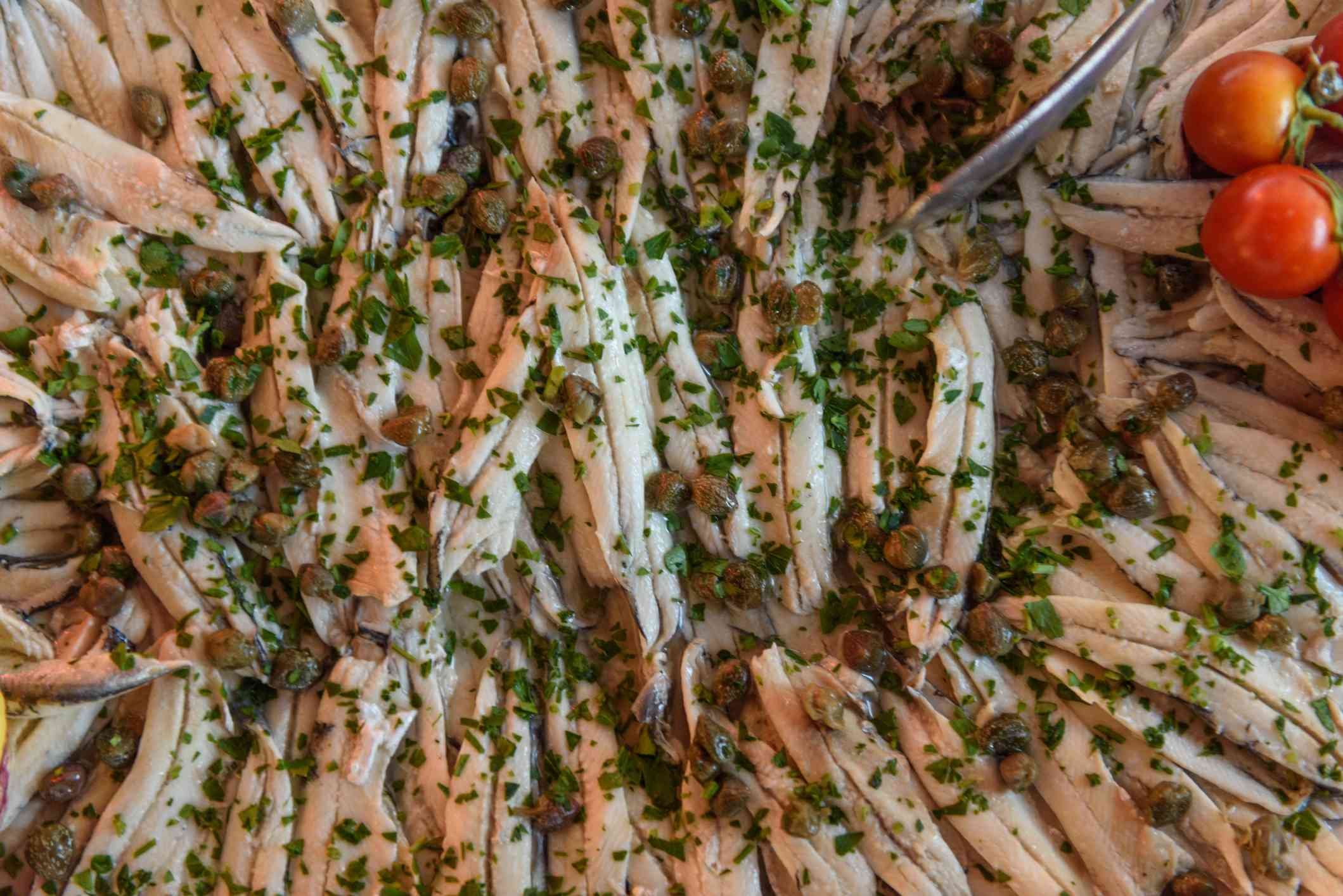 Close-up of a plate of marinated anchovies