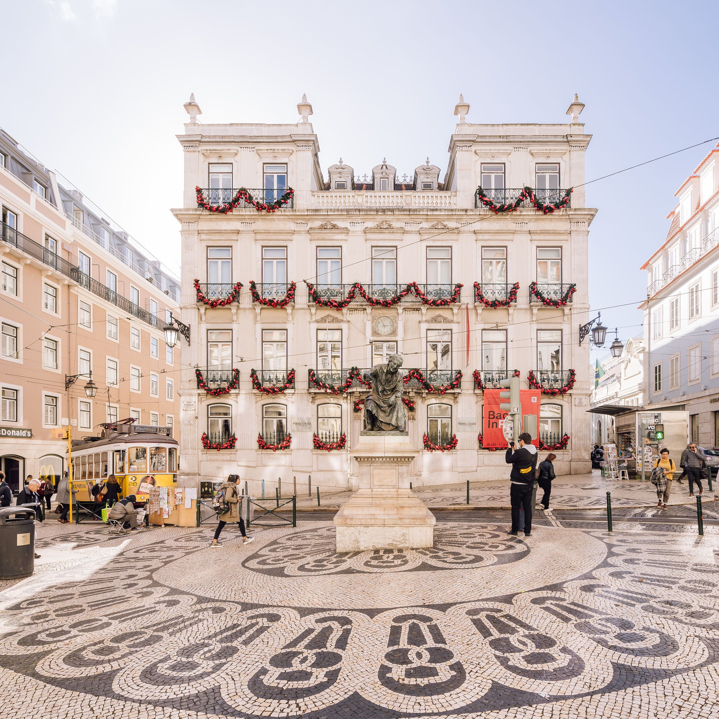 A public plaza in Chiado with a tiled street