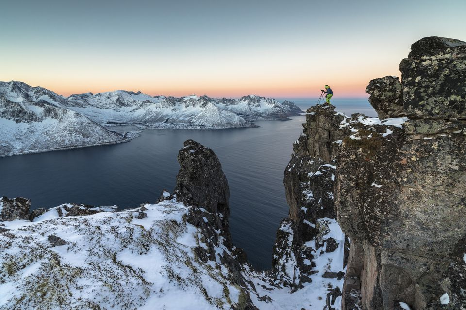 Photographer on the rocks, Senja, Norway