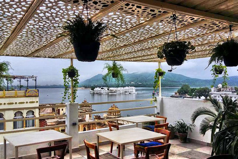 Waterfront restaurant patio with hanging plants