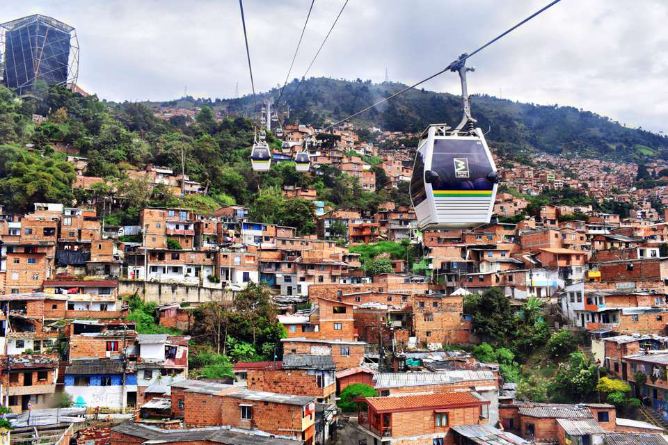 Cable cars gliding over the houses in Medellin