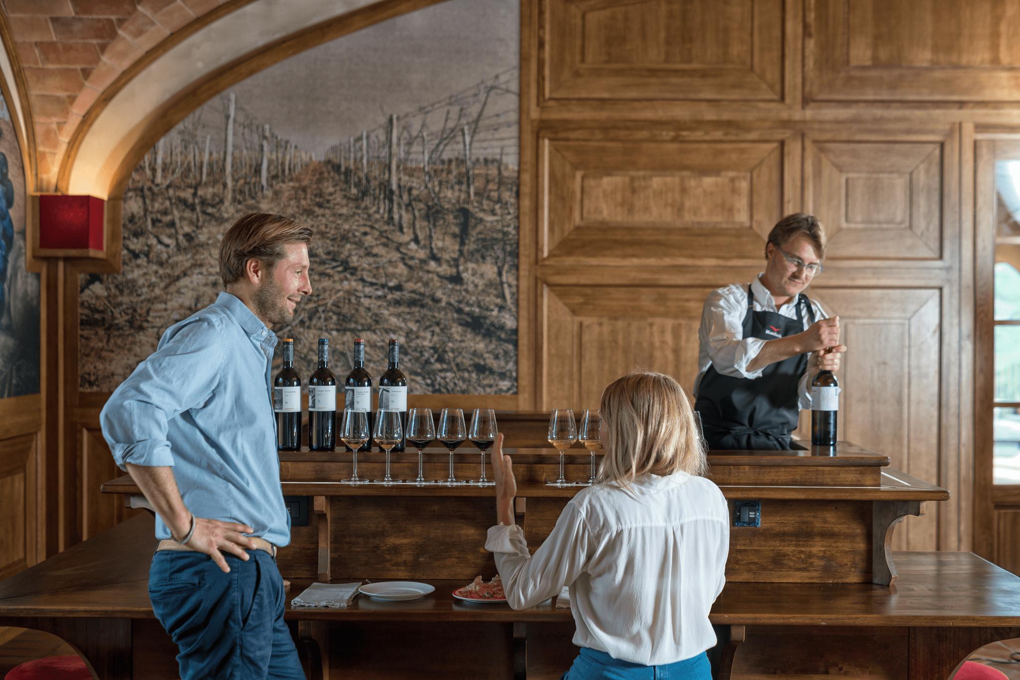 Couple enjoy a wine tasting in the Monterosola tasting room