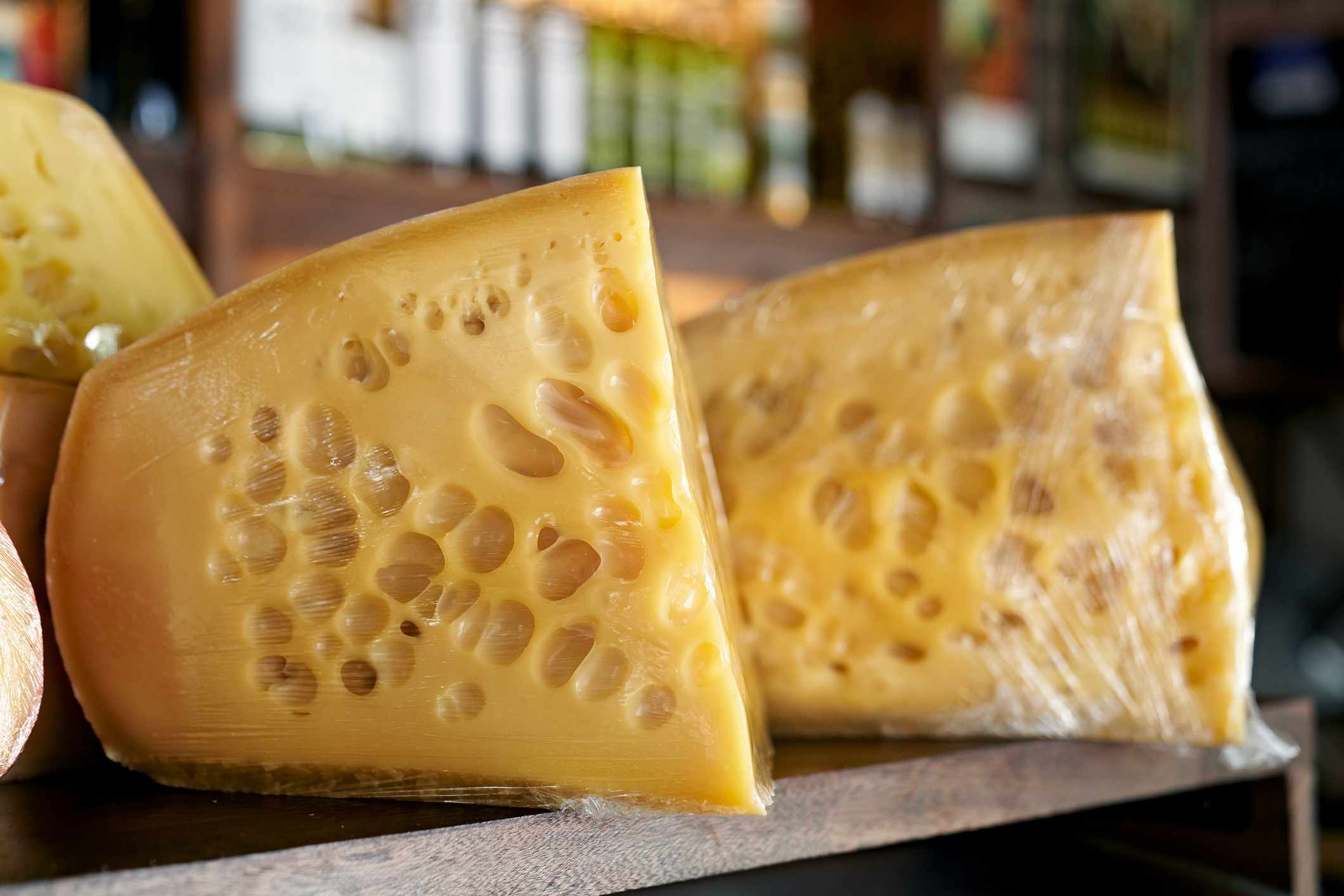 Swiss cheese for sale in a gourmet shop