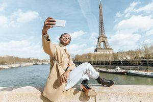 A woman taking a selfie in Paris