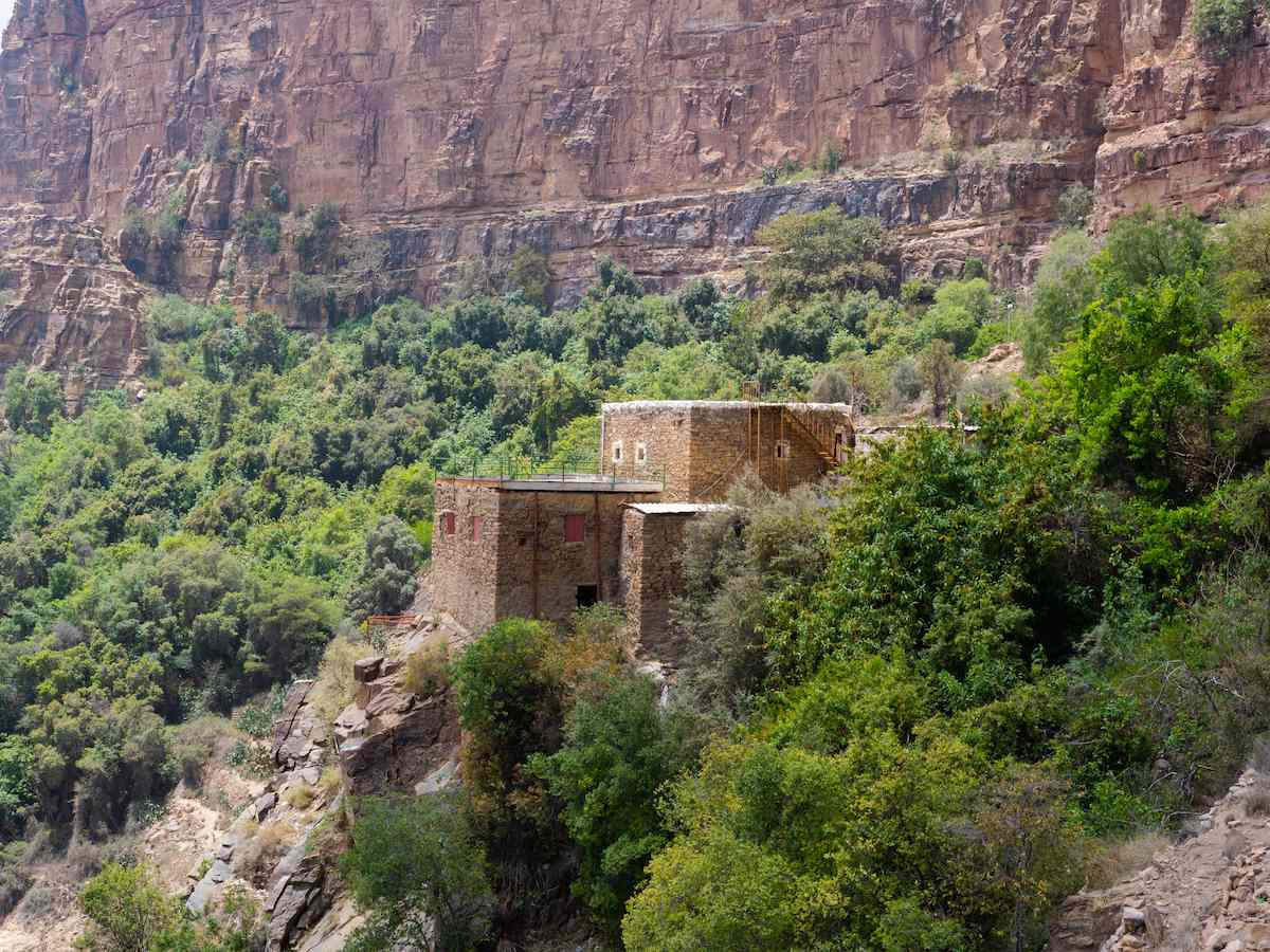 A building on the cliff face at Habala