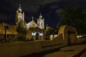 Albuquerque's San Felipe de Neri Church at nighttime