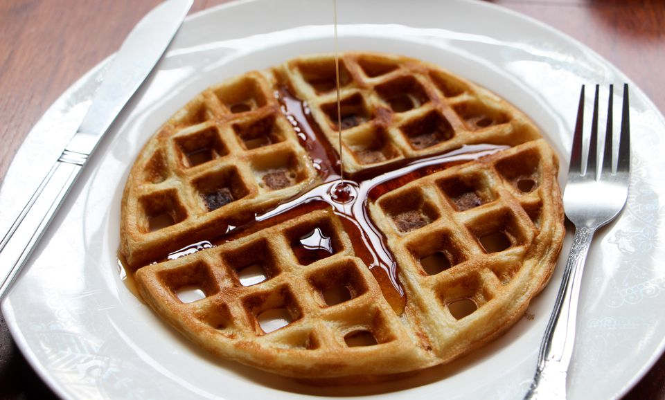 High Angle View Of Maple Syrup Falling On Waffle In Plate