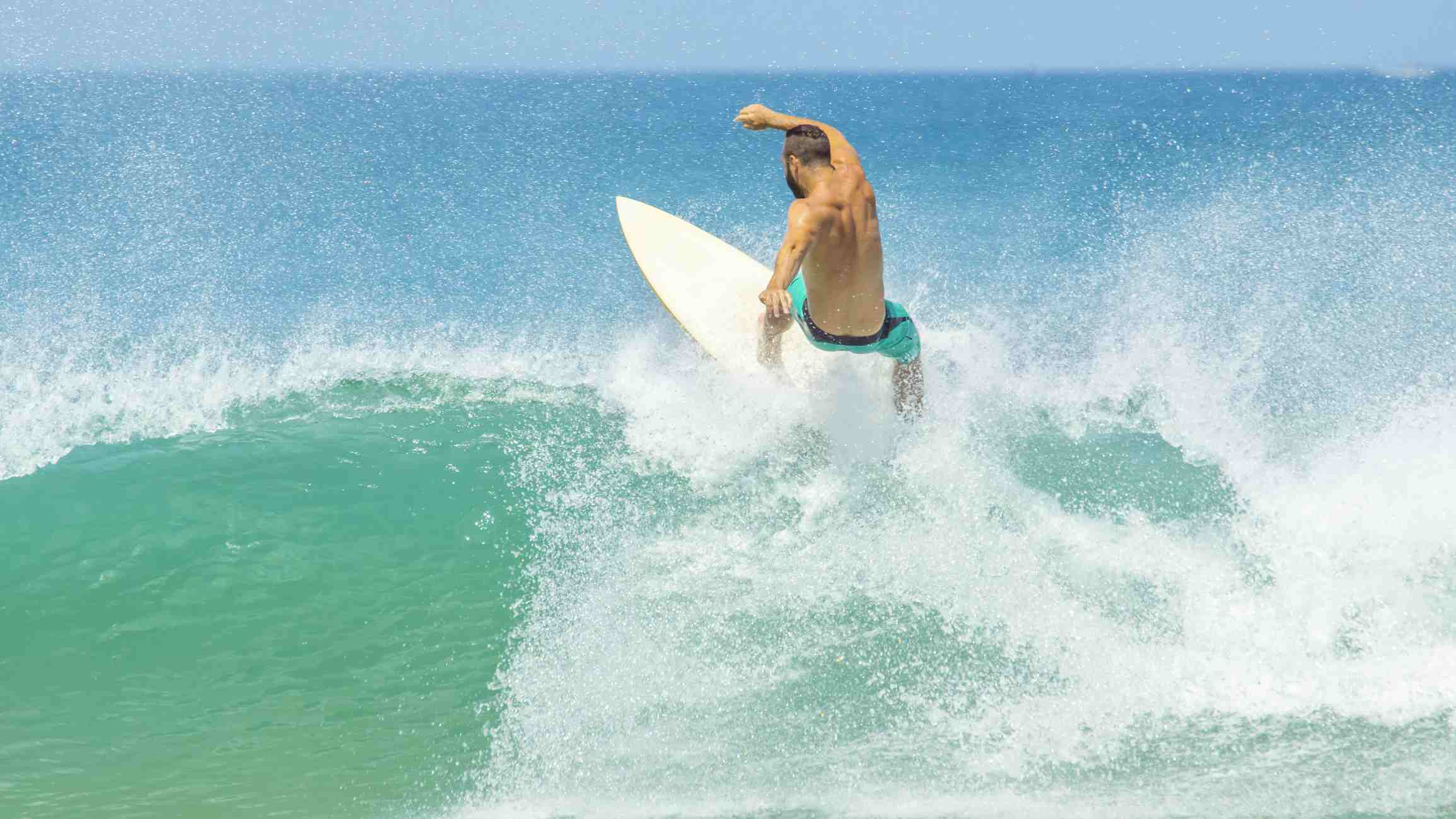 Surfer riding a wave at Tamarindo and Langosta Beaches, Costa Rica