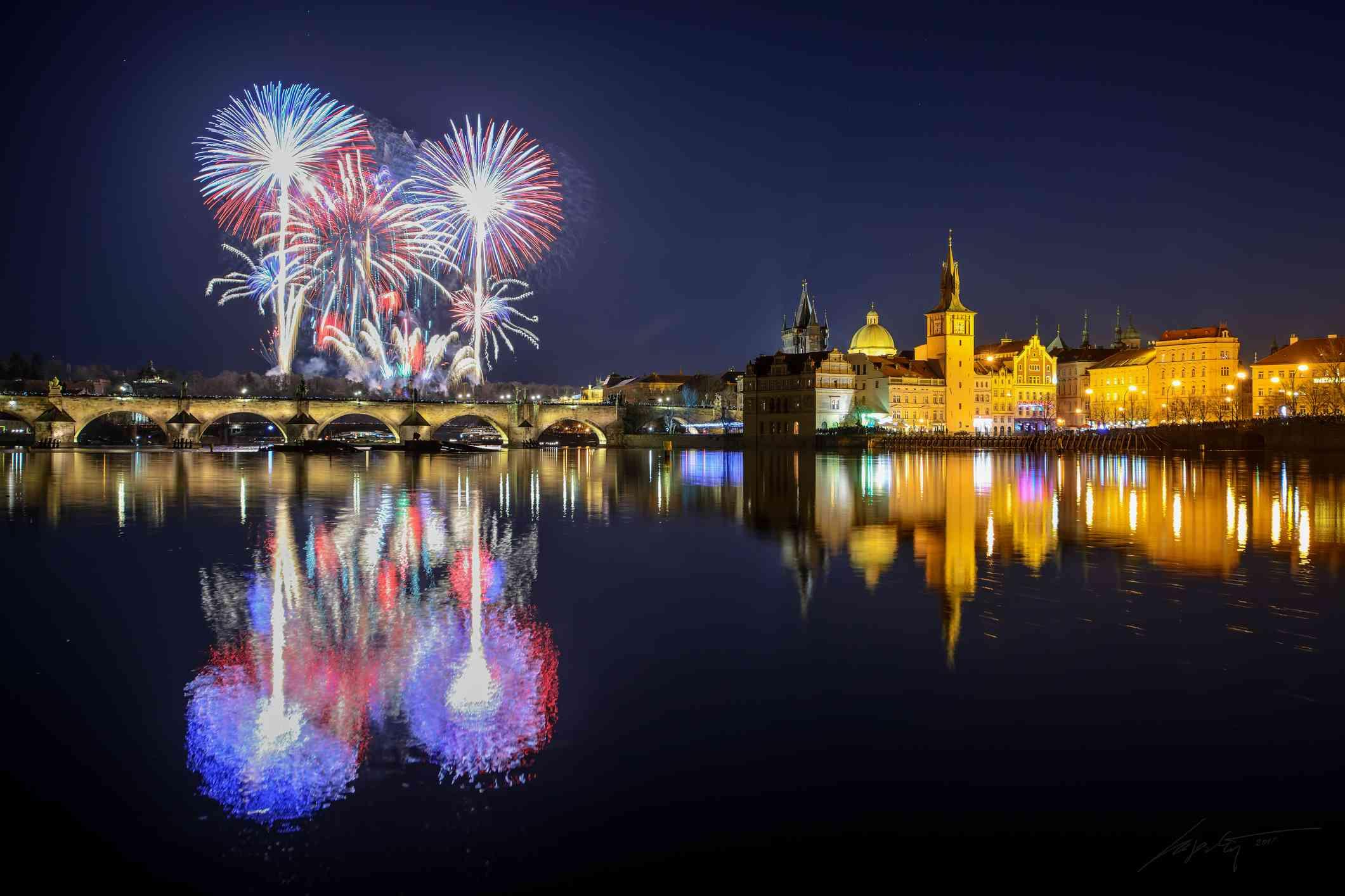 Prague fireworks during New Year Celebration near Charles Bridge, Prague, Czech republic