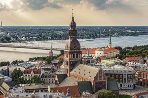 Latvia, Riga, cityscape with cathedral, castle, and Vansu Bridge