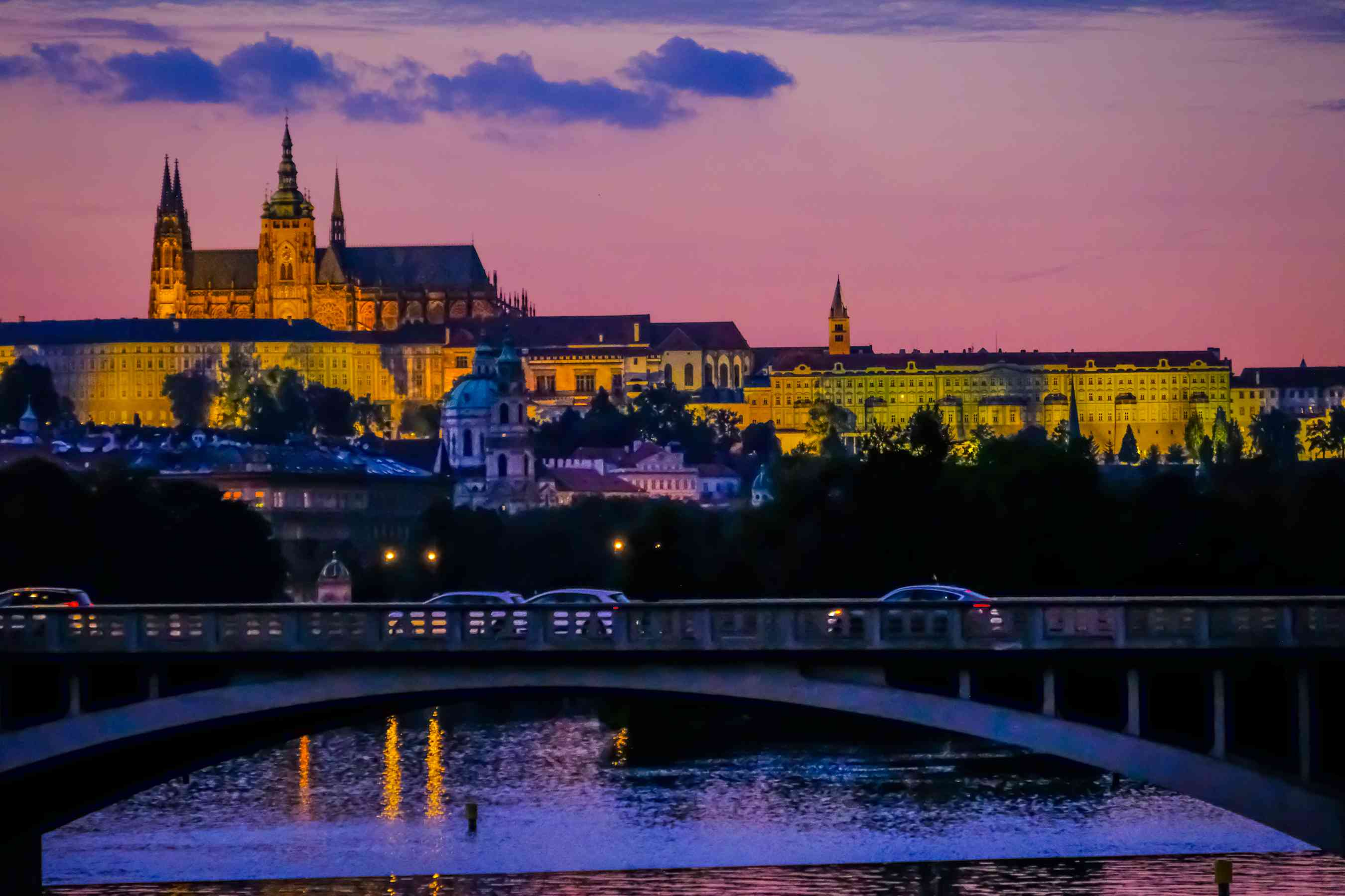 View of Prague at night with view of the Prague Castle lit up