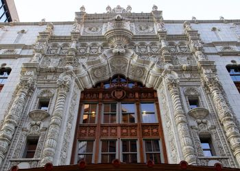 low angle view of intricate stone carving on the entrance to the Indiana Repertory Theatre
