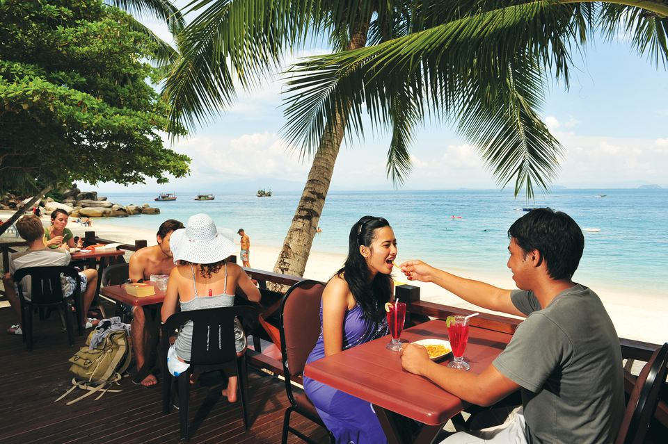 Tourists at a resort on Perhentian Kecil