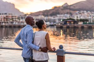 Black couple looking at sunset at Cape Town waterfront