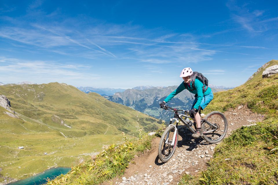 Female mountainbiker at Urdensee turn, Switzerland