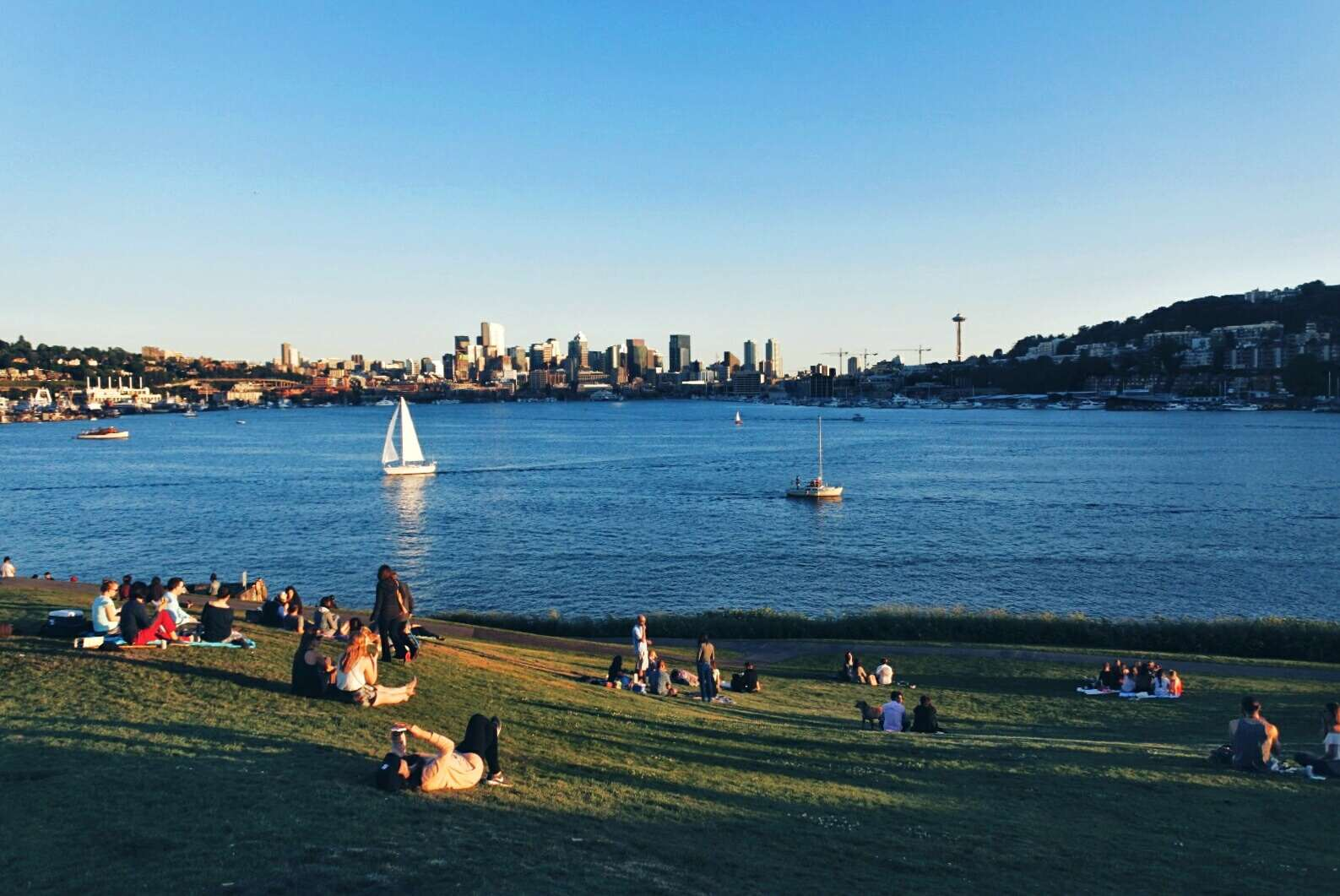 People At Gas Works Park By Lake Union Against Blue Sky