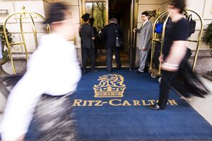 Doormen, guest and pedestrians at entrance to The Ritz Carlton Hotel, Central Park South.