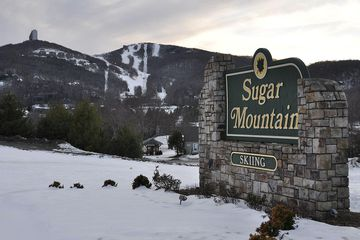 Sugar Mountain sign with Mountain and Ski Resort in background. 2009