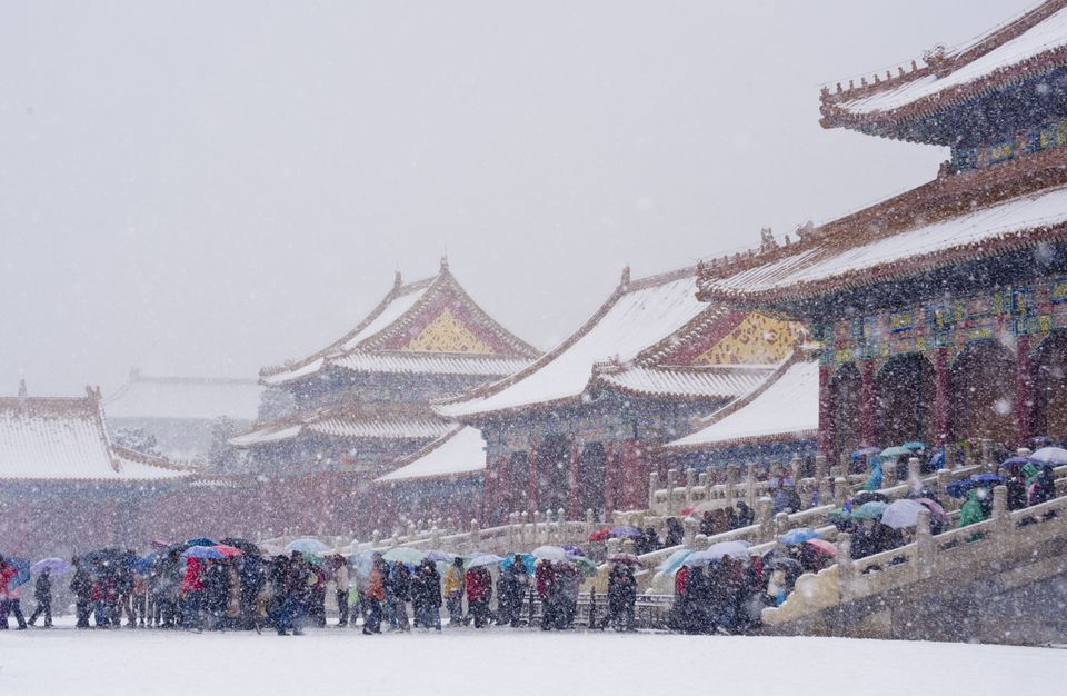 Snowing on tourists during Asia in winter