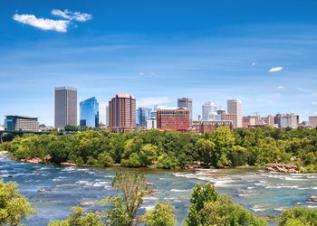 Richmond Virginia skyline over the James River on a beautiful summer day.