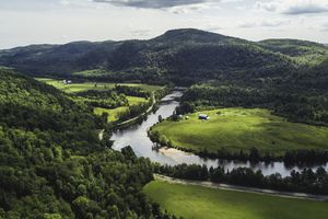 An aerial view of mountain and river in Quebec Province, Canada in the afternoon