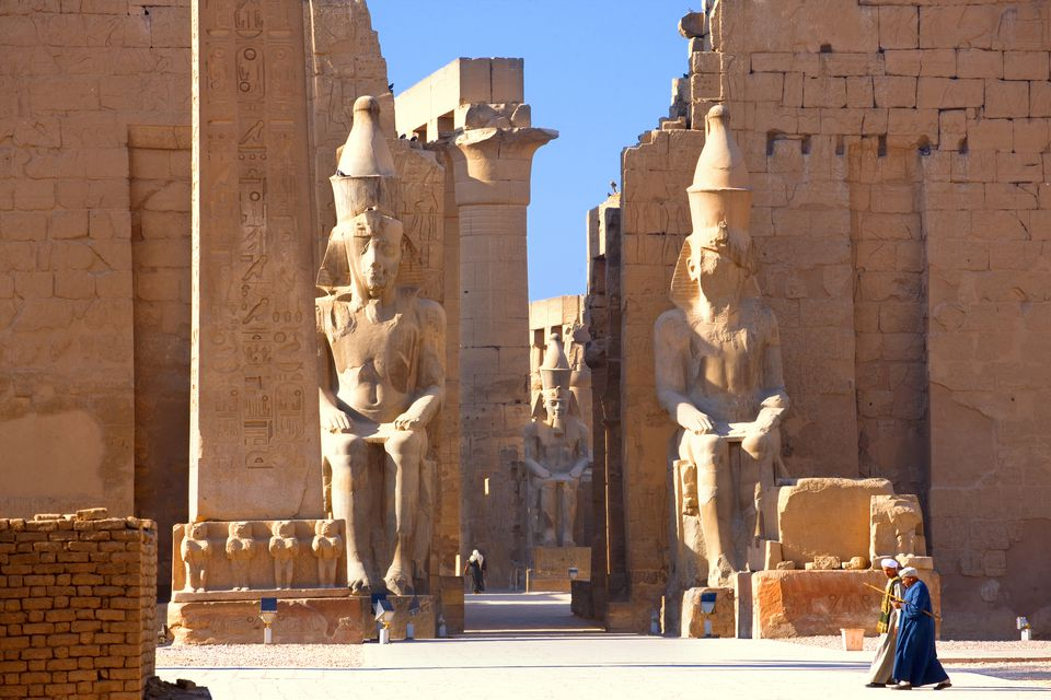Giant statues guard the entrance to the Temple of Luxor, Egypt