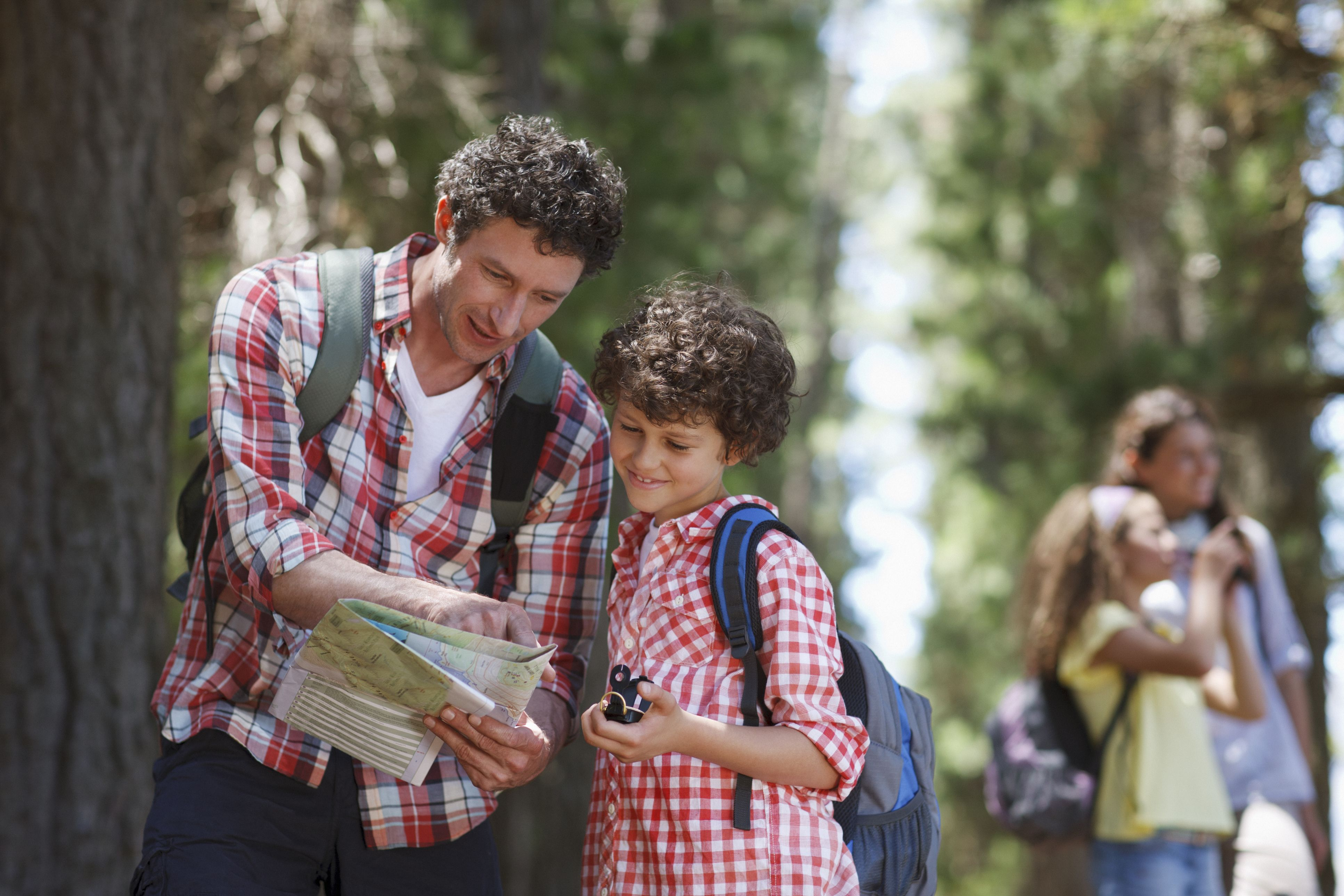 Boy and father reading a map