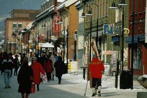 Male skier on main street, Lillehammer, Norway