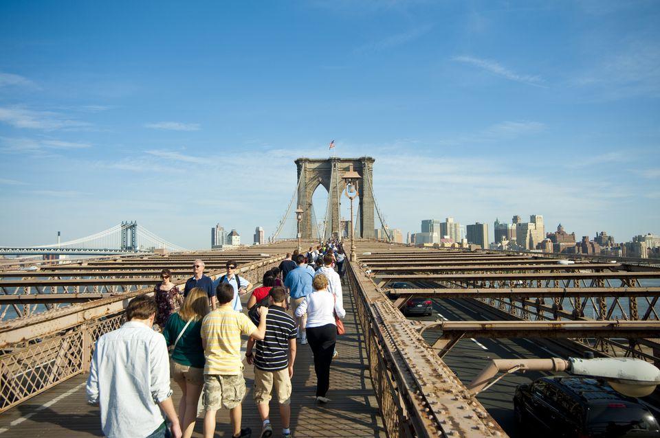 People Crossing Brooklyn Bridge Towards Brooklyn, New York, USA