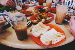 Food and drinks on a kopitiam table in KL