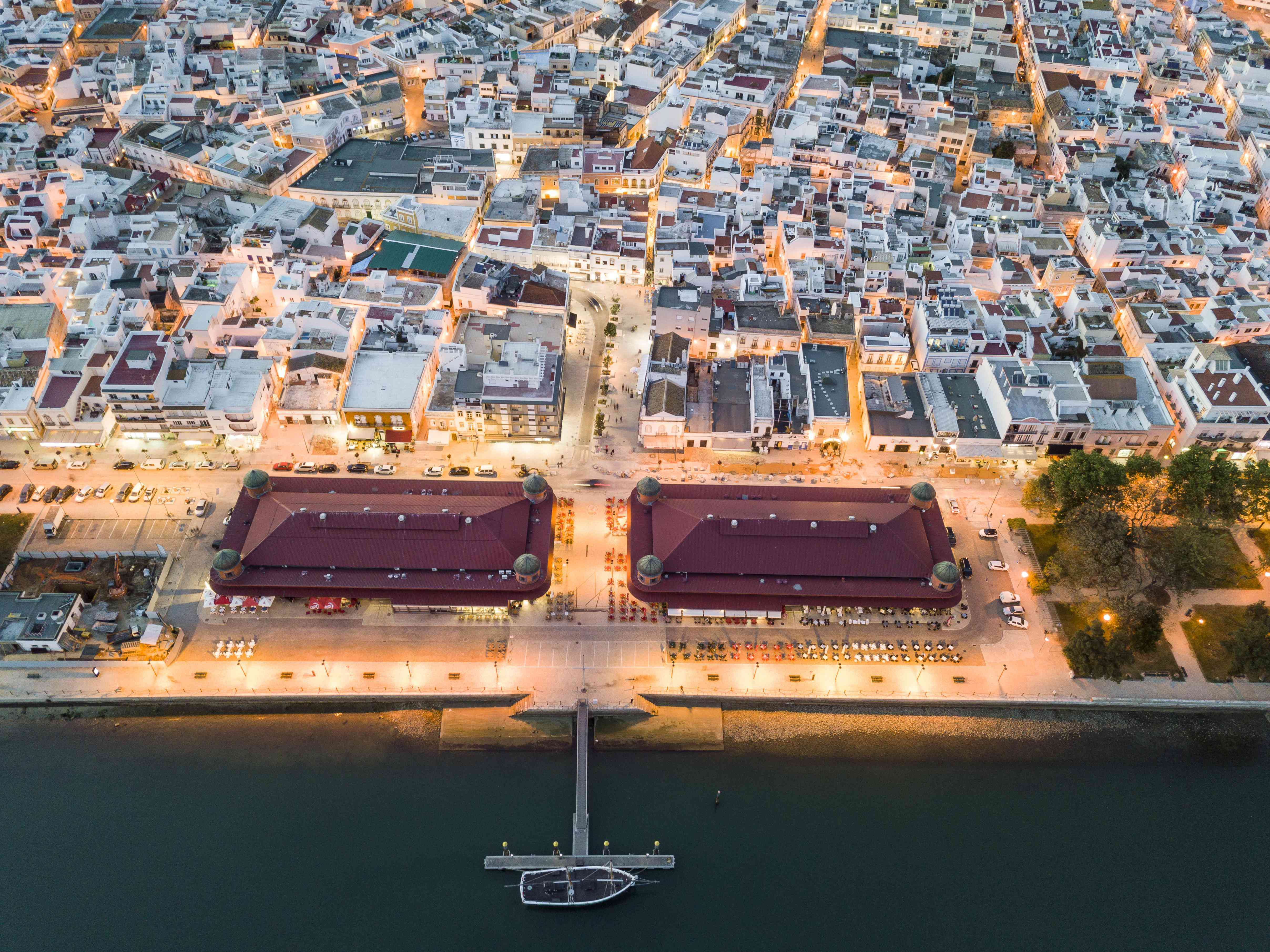 City view with two market buildings in the evening, river Ria Formosa, Olhao, Algarve, Portugal