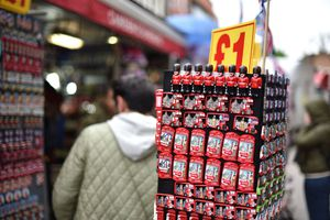 Tourists view London-themed souvenirs on a street in Camden